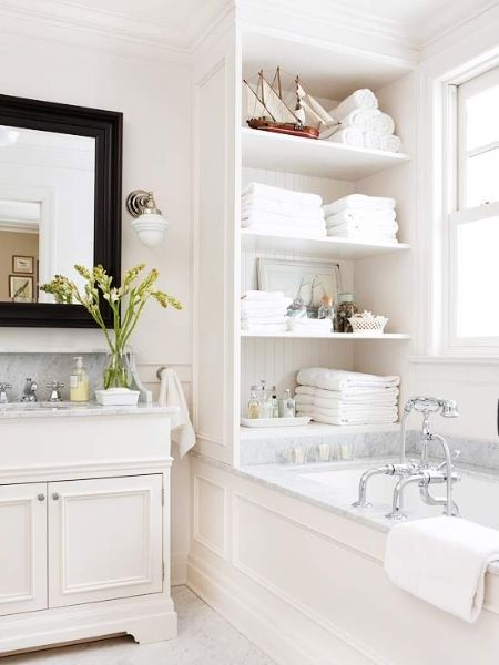 White bathroom with built in storage shelves