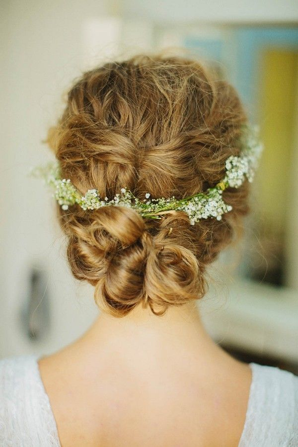 Low updo with baby's breath floral crown | Image by Photo by Betsy
