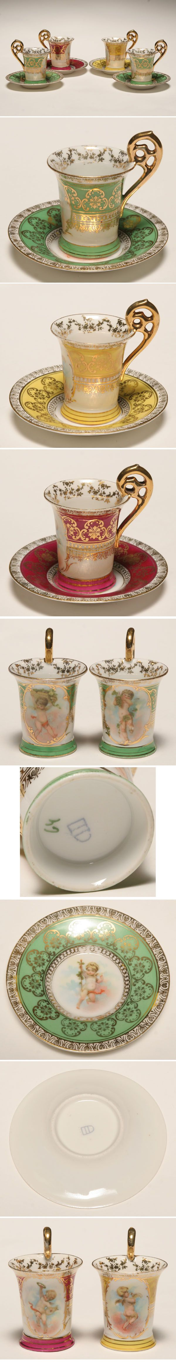 Royal Vienna porcelain demitasse cups and saucers; hand touched transferware with gilt accents . Beehive mark on bases.