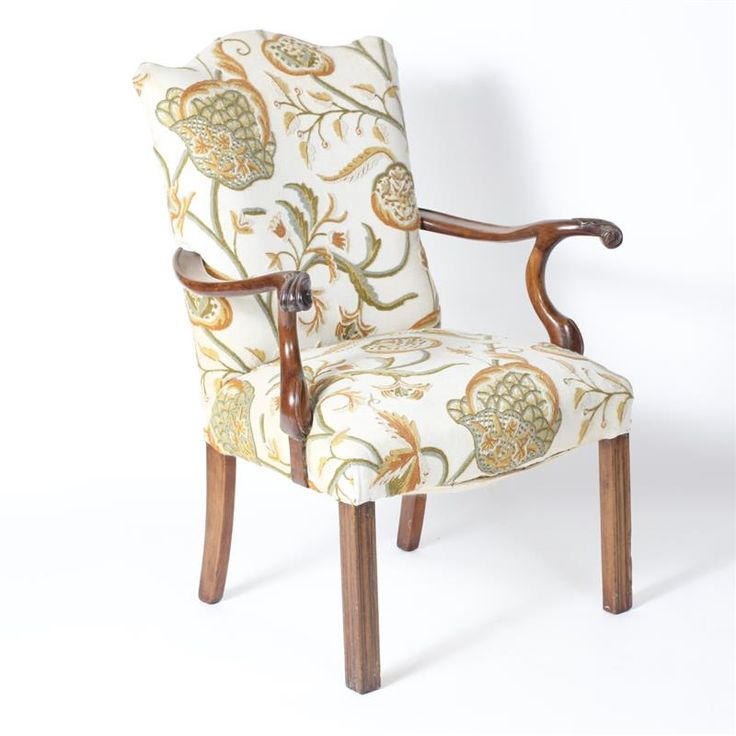 """Antique carved walnut arm chair with crewel stitch floral upholstery. H 38"""" x W 23"""""""