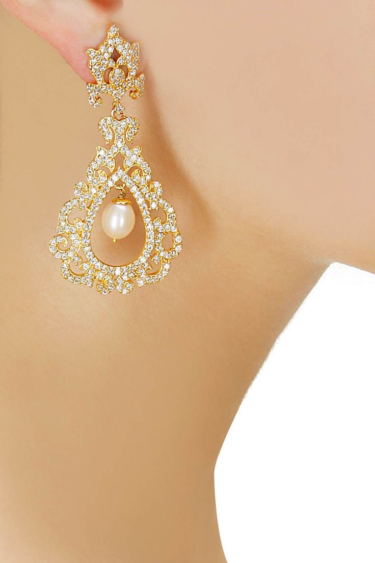 Gold finish pearl drop earrings available only at Pernia's Pop-Up Shop.