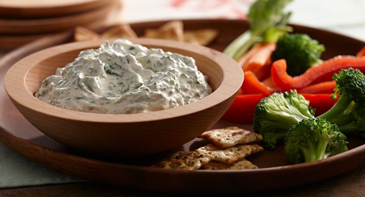Spinach Dip - Make this appetizer dip extra-special by serving in a hollowed out round bread loaf.  Cut the removed bread into bite-sized pieces to serve with the dip