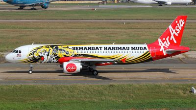 AirAsia (MY) Airbus A320-214 9M-AFI aircraft, painted in ''Malaysian Football Team'' special colours Aug. 2012, with the sticker ''Semangat Harimau Muda'' on the airframe, skating at Vietnam Ho Chi Minch City Tan Son Nhat International Airport. 19/01/2016. (Harimau Muda=a former Malaysian under-22 football team).