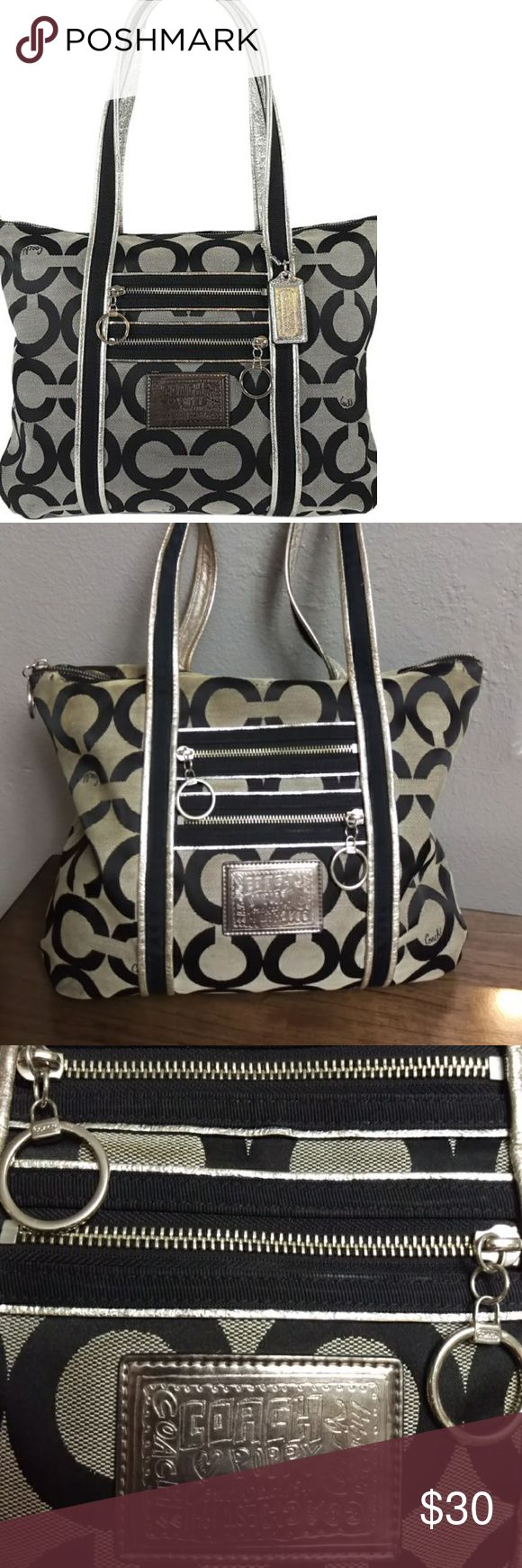 """Coach Poppy Duffle Large Tote Coach Poppy Duffle Large Tote black and gray exterior with purple interior, large zipper compartment, 2 smaller compartments, 2 zipper exterior pockets, size 16""""x14""""x4""""- has a lot of wear and scarfs on top(see pictures for details). But still has plenty life in it. Asis Coach Bags Totes"""