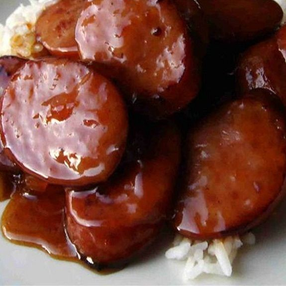 Slow cooker barbecued sausage pieces. Smoked sausages with hickory-flavored barbecue sauce cooked in slow cooker.Very easy and delicious recipe.