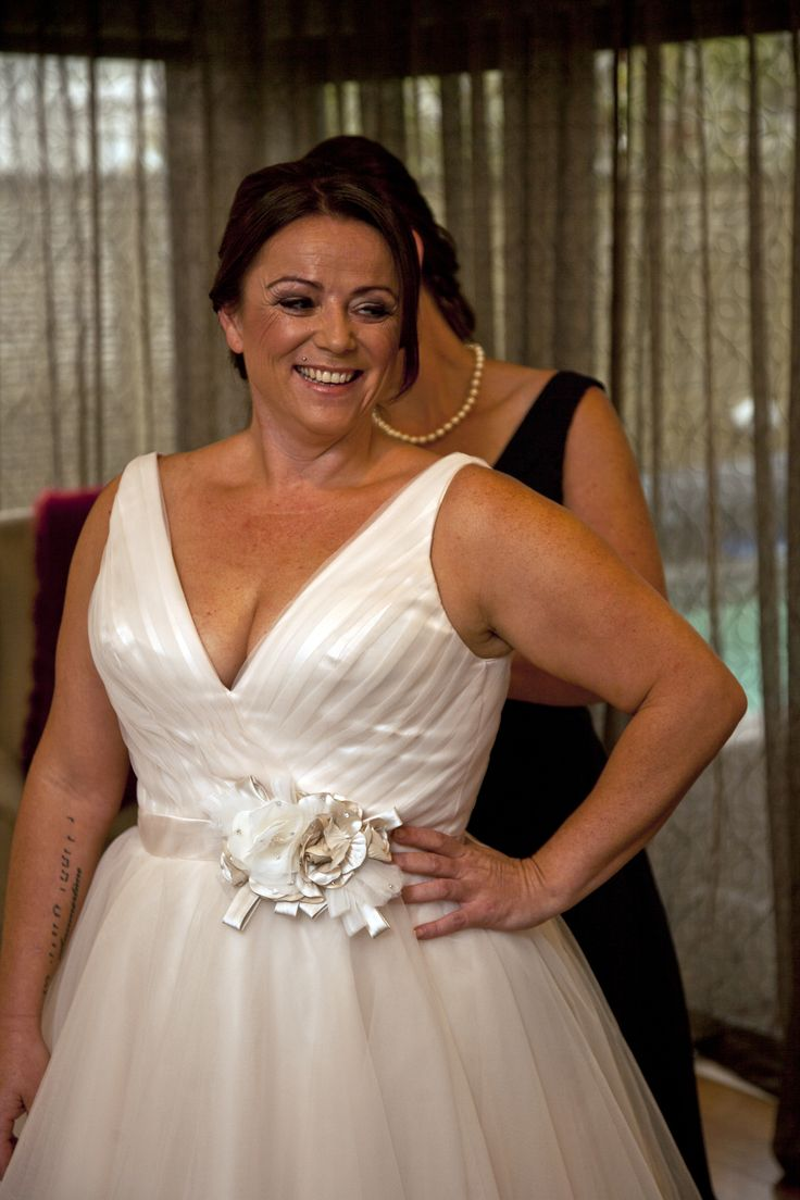 Lisa is wearing a T-dress by Allure Bridals 2015 from Jenny's Bridal