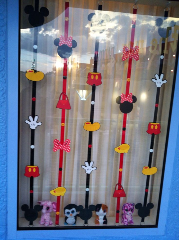 Window decorations at the Pop Century Resort at Disney - created with a Cricut machine, some imagination, and a little help from a friend!