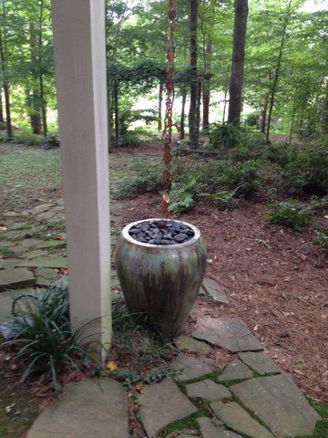 This customer added a large urn with rocks to minimize the amount of runoff flowing out and corroding their ground. Smart solution and looks great too!