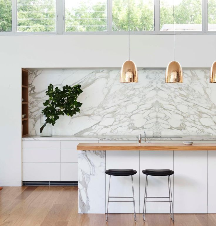 MUST-HAVE MODERN LIGHTING: hammered pendant lights in gold over a #contemporary #kitchen island