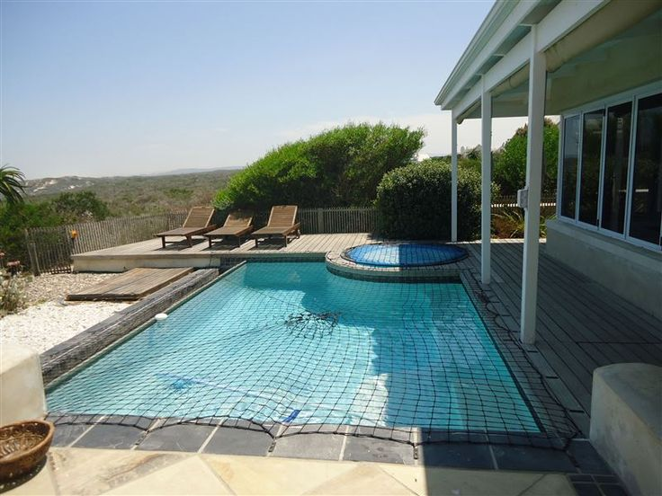 Pelican Villa - Luxury villa set in a private nature reserve, with four double bedrooms each with its own bathroom. The house offers a pool and jacuzzi, washer and dryer, wood and gas braais, garaging for two cars, alarm ... #weekendgetaways #grottobay #southafrica