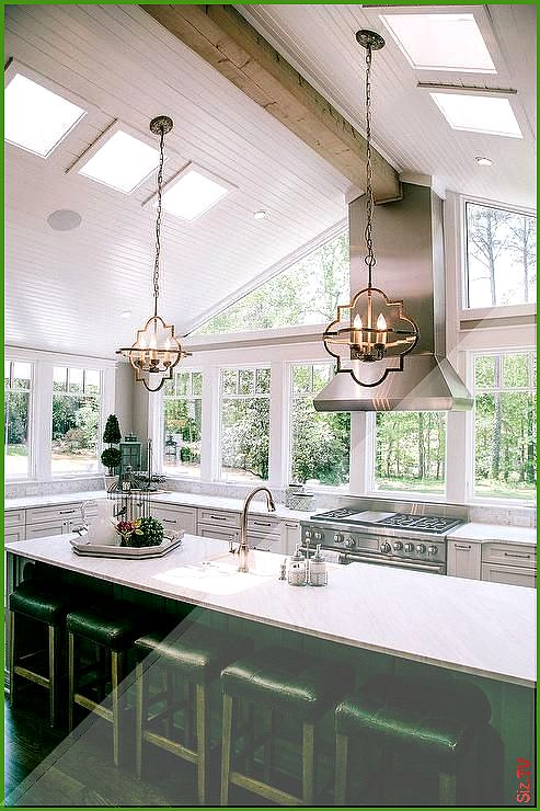 Gorgeous kitchen features a vaulted ceiling accented with ...