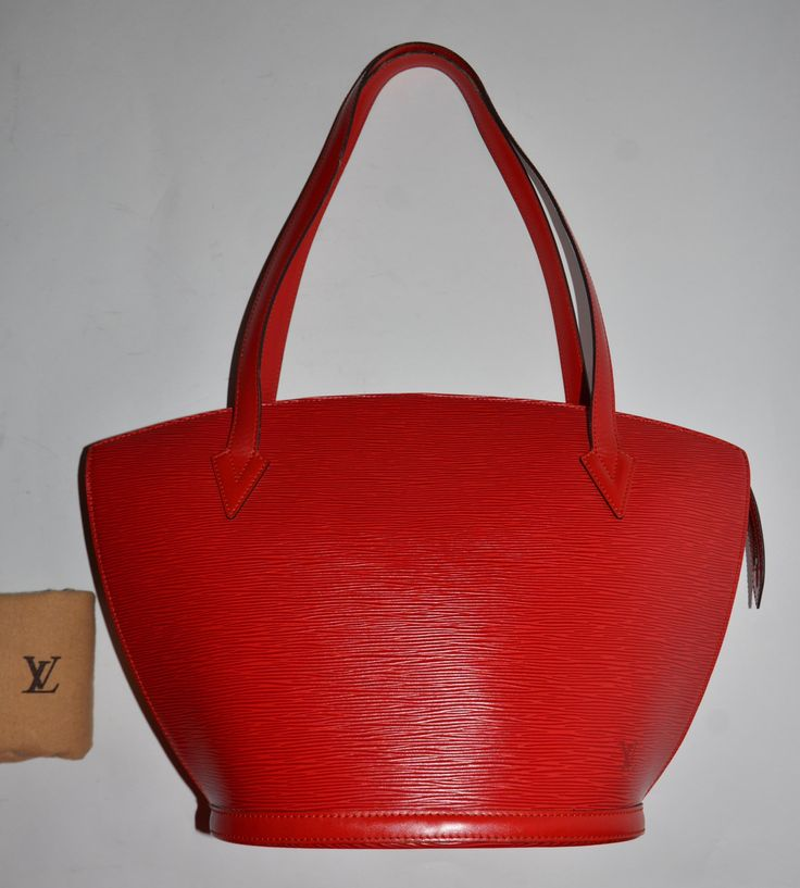 Louis Vuitton Epi Saint Jacques Red Tote Bag. Get one of the hottest styles of the season! The Louis Vuitton Epi Saint Jacques Red Tote Bag is a top 10 member favorite on Tradesy. Save on yours before they're sold out!