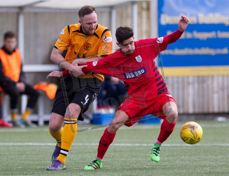 Queen's Park's Paul Woods fights off the challenge during the SPFL League Two game between Annan Athletic and Queen's Park. PICTURE