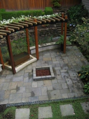 trellis, terraces, stairs up the hill, firepit