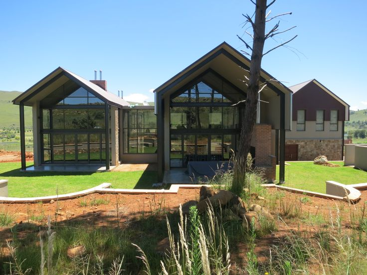 The rear view of this magnificent barn style home.
