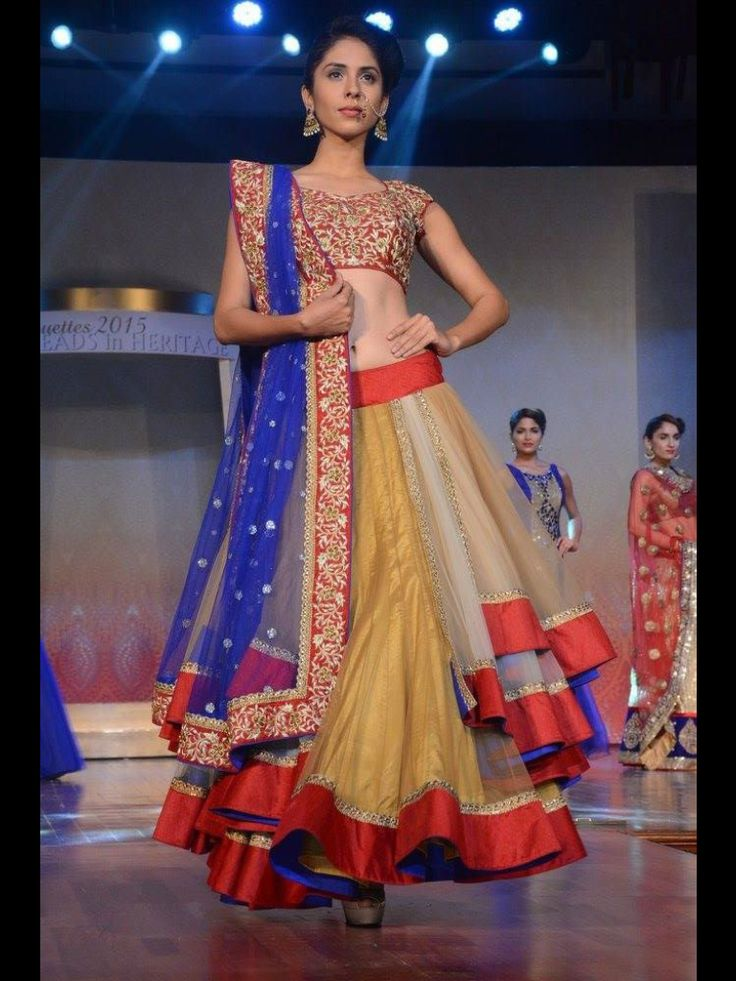 Three layoured chaniya on net with heavy work of emboss kasab and stones, only at manish reshamwala fashion studio, 9879568040