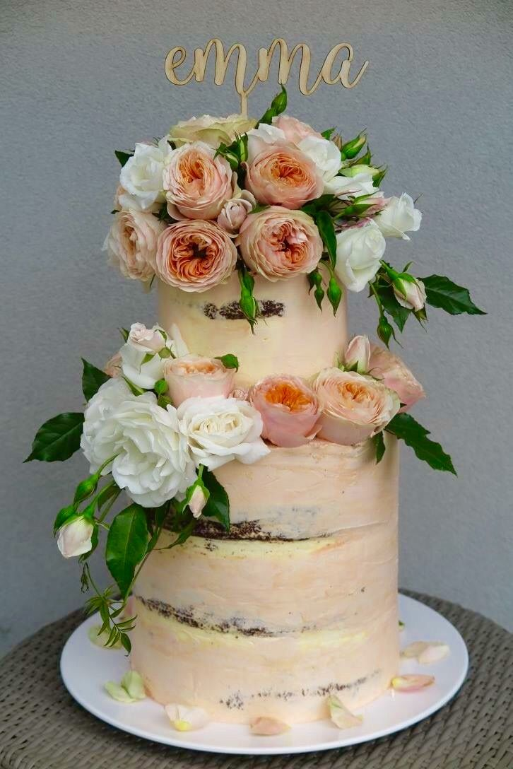 Peach and Cream christening cake with fresh flowers.