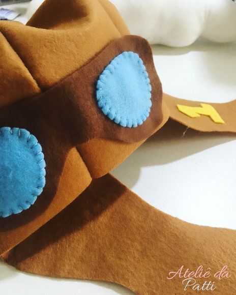 Chapéu Gorro Aviador em Feltro!    Serve em crianças de até um ano!  É possível fazer alterações em relação às cores! Consulte-nos! :)