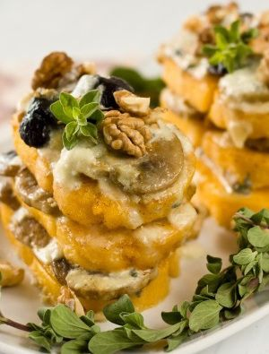 Fried polenta with mushrooms and Gorgonzola sauce.This is very delicious Italian appetizer.Fast and easy to cook.An excellent starter for Christmas party!