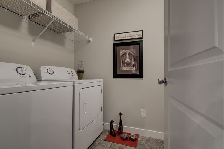The laundry room is located at the back of this show suite, tucked away and…