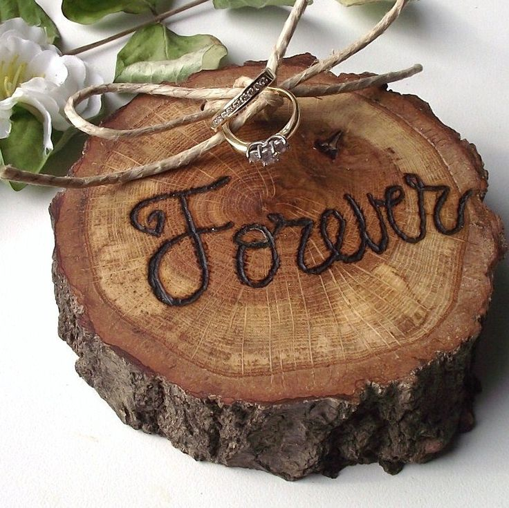 rather than going for a traditional pillow or basket, how about a rustic and natural addition, like this Ring Bearer Wood Slice