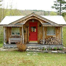 a sweet traditional cabin exterior using vertically oriented unpainted board batten siding
