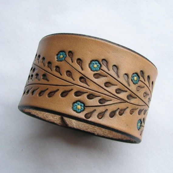 Ugh. Gorgeous. It will be mine.     Little Blue Flowers on a Wide Leather Wristband by aosLeather, $25.50