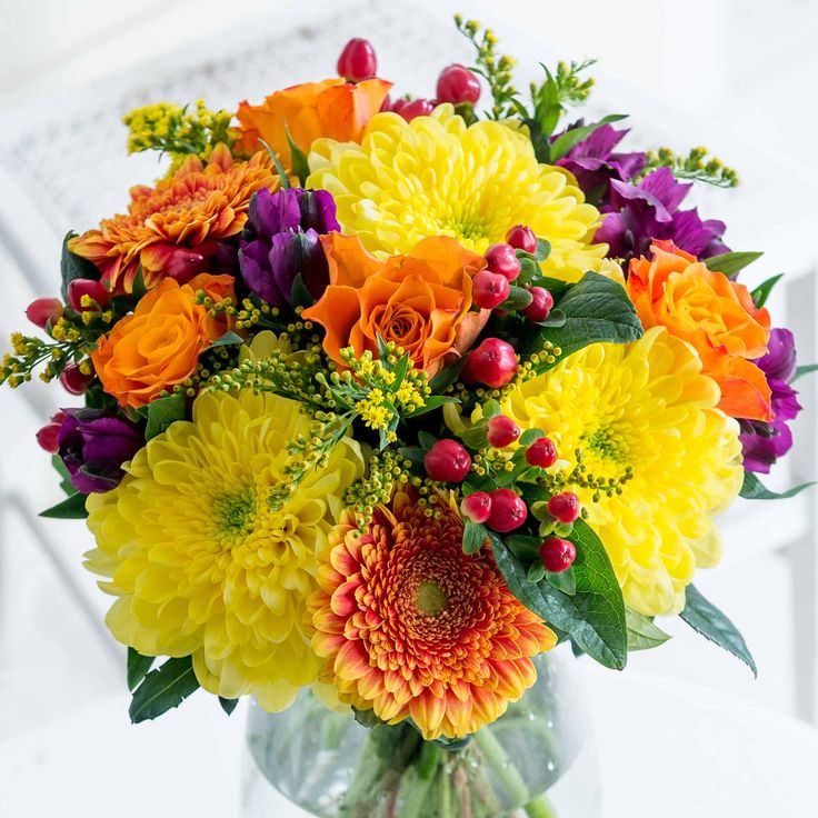 Bright Autumn Days: Bring a little Autumnal warmth into their home with our Bright Autumn Days bouquet. We're sure they'll adore the bright colours of this striking bouquet.
