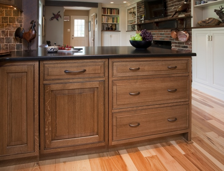 View of inset dishwasher with matching cabinet panel for Period kitchen cabinets
