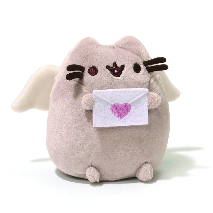 """The adorable Facebook kitty, Pusheen, is here for you to hug! The chubby gray tabby cat that loves cuddles, snacks and dress-up has been made into plush by Gund. This lovable 4.25"""" plush Cupid Pusheen"""
