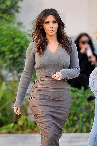 """By Us WeeklyShe's back!Though new mother Kim Kardashian has been rocking blond locks since her daughter North was born in June 2013, the 33-year-old reality star decided to return to her darker roots, dying her hair back to brown.PHOTOS: Kim's post-baby body style""""I'm back,"""" she captioned the Instagram photo of her new brunette tresses, before sharing another image on MobioInsider, writing, """":-) Love change.""""The newly engaged star is planning a summer wedding with fiance Kanye West, so her…"""