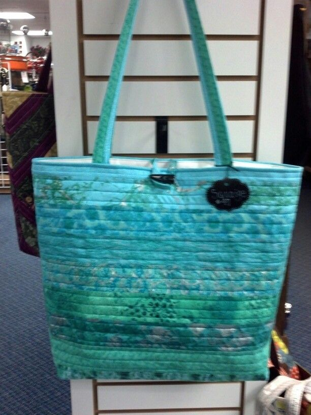 Large quilted tote bag made from 10 horizontal jelly roll strips.