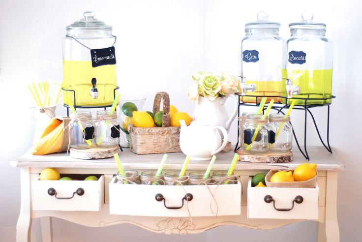 Classy lemonade station. Perfect decor for lemonad bar with mason jars, antique table and flower details