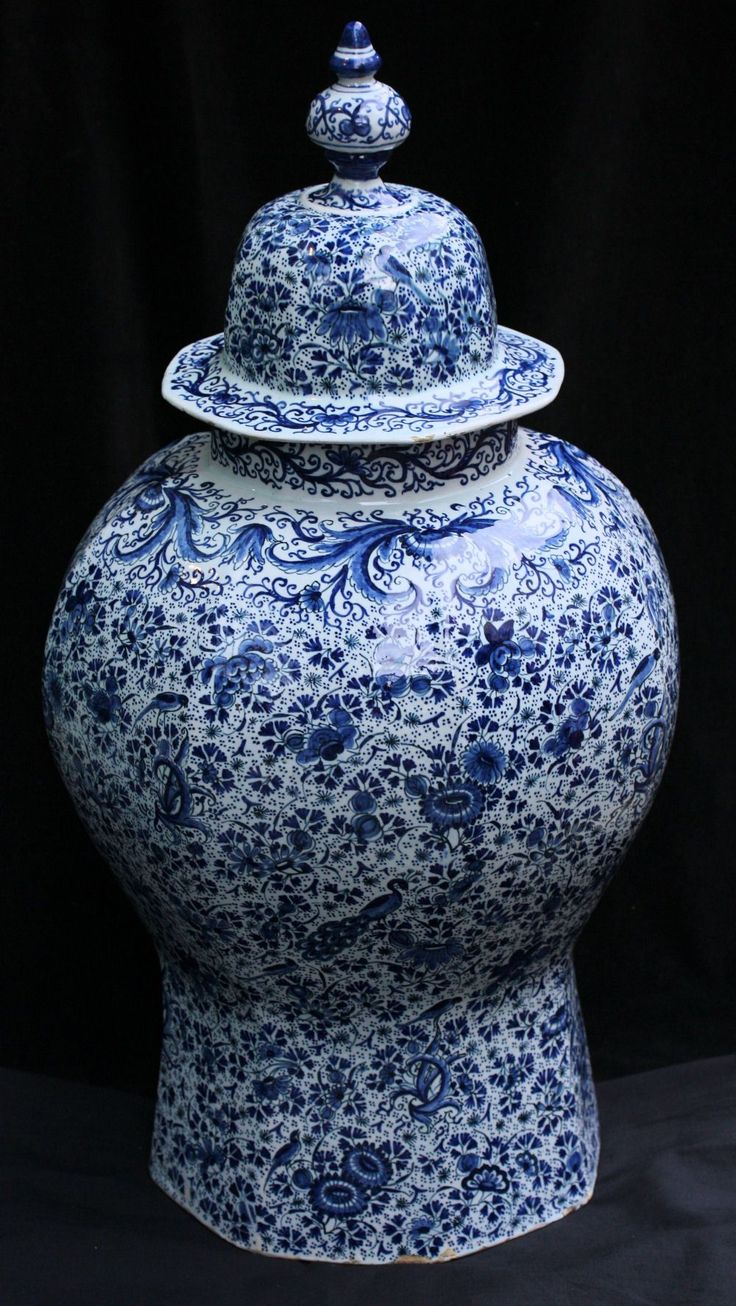 Large Dutch delft jar and cover c. 1700, decorated overall with birds in branches ,flowers and leafy scrolls against a speckled background with a mark in blue on the base which appears to be JH with the number 5 underneath possibly for Jan Ariensz van Hammen, owner in 1661 of the Dobbelde Schenckan and he may have also have had a pottery in Lambeth; height: 28 in. 71cm.
