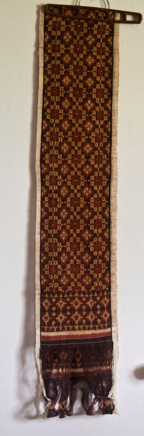 Gringsing, double ikat from Tenganan, Bali This piece is a Gringsing -- a ceremonial cloth handwoven using the double ikat method in Tenganan, Bali. This was purchased from the weaver and dates to the early 1990s.
