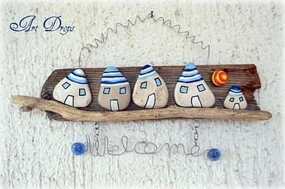 welcome sign from painted stones and driftwood