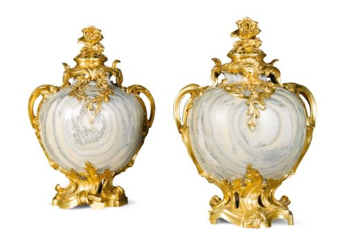 A pair of French gilt-bronze mounted cippolino mar…