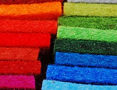 Filzfelt is an ecological, sustainable, and renewable material available in 54 colours available and in 5thicknesses. Most FilzFelt colors are matched to the Pantone Matching System, however a limited selection are stocked.    The material is produced from virgin wool, the sheep's wool is cleaned, carded, and the fibers aligned into batts. It is then compacted and joined by moisture, heat, and agitation until a homogeneous fabric is formed – wool felt.