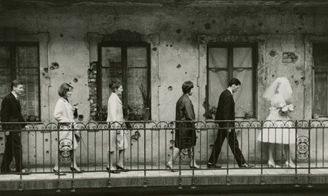 Wedding, Budapest, 1965 by László Fejes, which, with its depiction of bullet holes in the wall, led to Fejes being banned from publishing his photographs. Photograph: Hungarian Museum of Photography