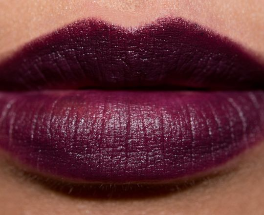 """MAC Smoked Purple Lipstick Review, Photos, Swatches- okay, so this was also on the """"good"""" list for me, plums. I would love to attempt this color. Now i have 2 reasons not to, 1) says so that dark colors make small lips look smaller (not good for my top lip) 2) the girl who is wearing this color down below looks like a witch with this color on. Might just not be for her, and maybe i can pull it off in a lighter, or softer color?"""