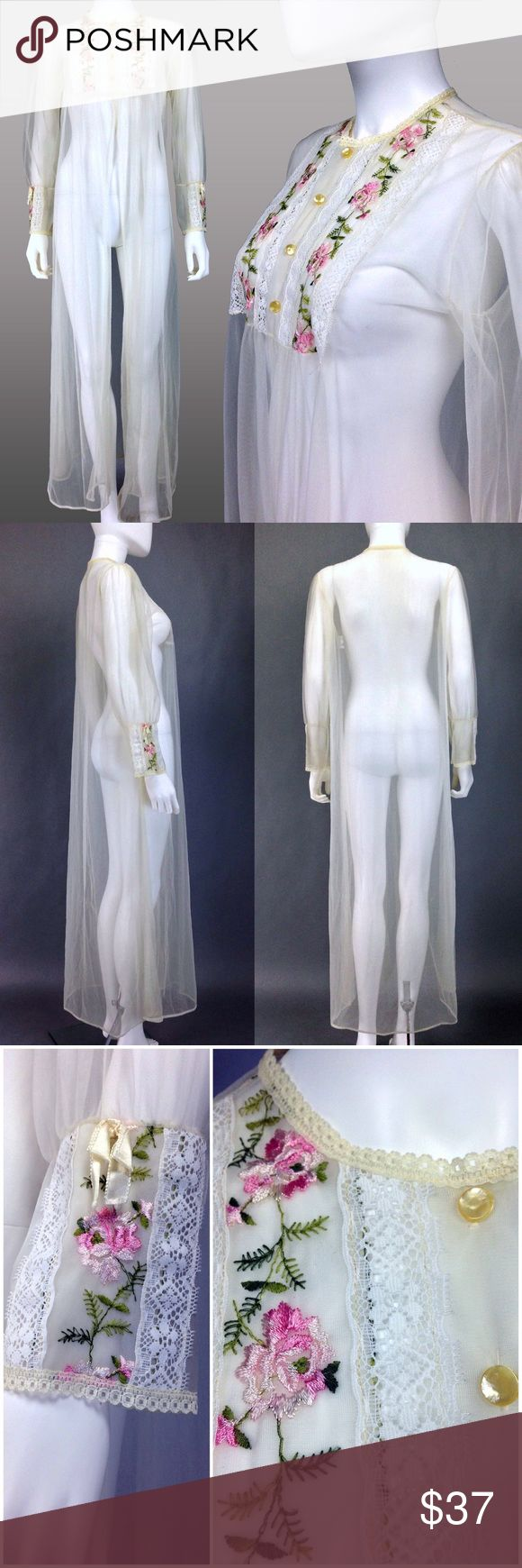 """VINTAGE LINGERIE 70s Peignoir Robe SHEER Floral Awesome vintage 60s-70s peignoir robe.   •Sheer white nylon •Floral embroidery & white lace trim on bib & cuffs •Mother of pearl buttons •Blue union label  CONDITION: Good vtg condition w/ 1 long thin run on front from under bib to hem; a few dings/snags here & there-see last pic. Flaws aren't very noticeable due to the sheer fabric.  MEASUREMENTS: •Shoulders:14"""" •Bust:38"""" •Waist:free •Hips:free •Sleeve:22"""" •Length:51""""  ☑️Top Rated Seller…"""