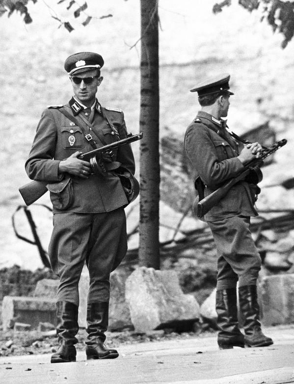 Soldiers from the East German National People's Army, man an unfinished part of the Berlin Wall, 1961