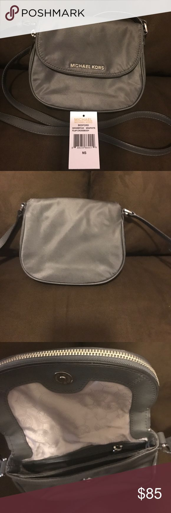 Authentic Michael Kors Crossbody Handbag! Authentic Michael Kors BEDFORD GRAPHITE FLAP CROSSBODY Handbag! Excellent Condition! Worn Once. Happy Poshing😀 Michael Kors Bags Crossbody Bags