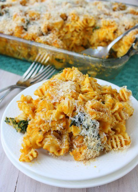 Skinny Pumpkin Pasta Bake (1 lb dry pasta (penne or rotini work well), 2 T butter, 1 finely minced shallot, 1/2 t freshly grated nutmeg, 1 t thyme, 1 bunch kale: thick stems removed and leaves chopped into 1-inch pieces, 1 29oz can pumpkin puree (not pumpkin pie filling!), 1/4 C shredded parmesan, 1/4 C shredded sharp cheddar, 1/2 C lowfat milk, 1/4 C panko breadcrumbs, salt and pepper)