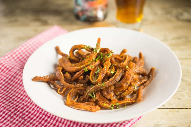 Embrace a nose to tail philosophy of sustainable eating with this WTF?!A Crunchy Buffalo Pig Ear Strips Recipe!Crispy fried pig ears strips in buffalo sauce