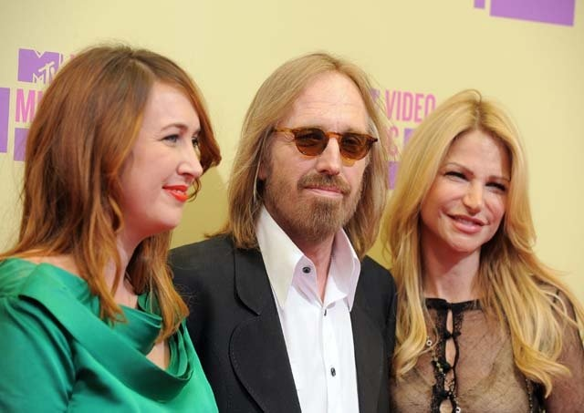 Singer Tom Petty, center, arrives with his wife Dana ...