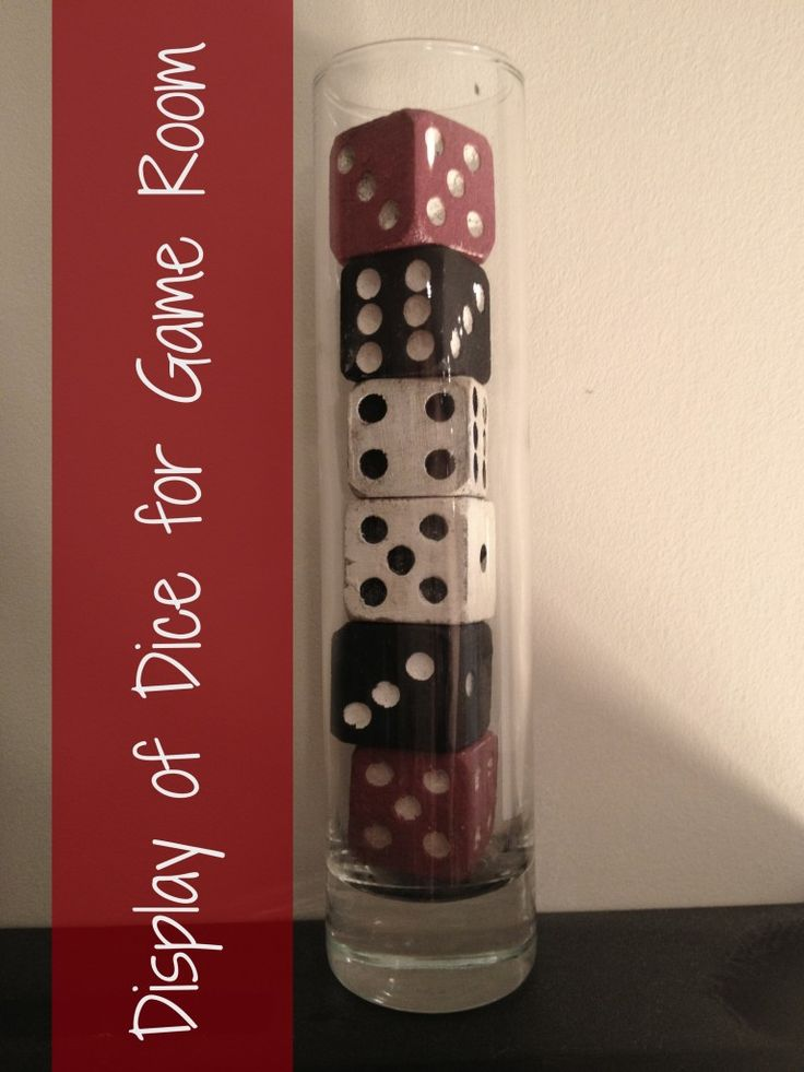 More Family-Themed Vintage Game Room Ideas dice from Pottery Barn stacked in vase