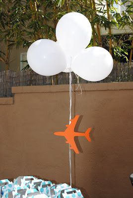 "airplane party--""cloud"" balloons with airplane flying below . . ."