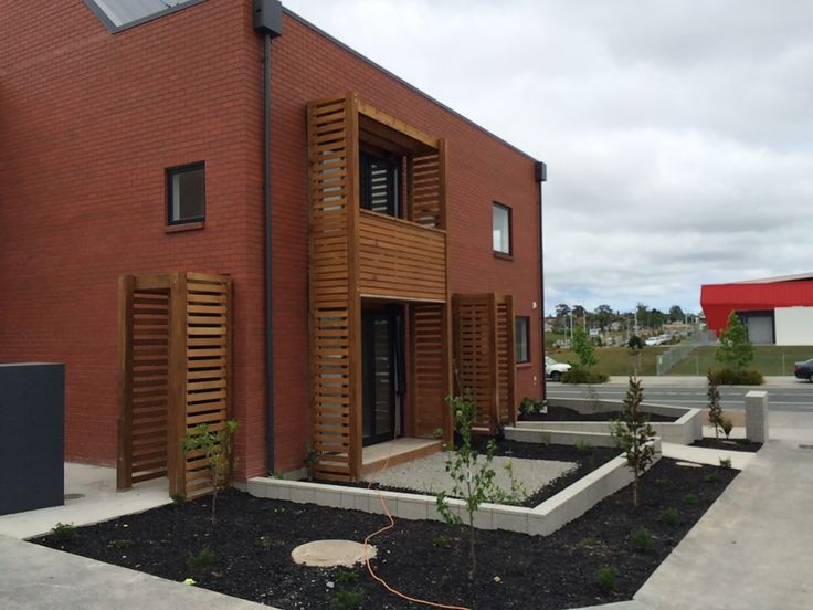 Striking red-brick finish to these modern terraced houses in the new Auckland development at Hobsonville Point - 11 November 2015