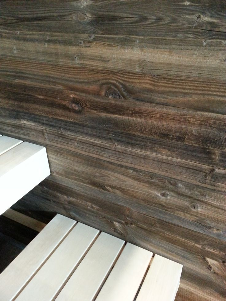 Close-up from a sauna interior walls in rough thermo-wood, benches in aspen made by abisco.be ®